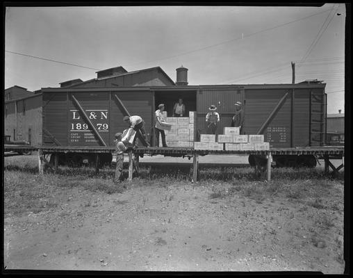 James E. Pepper Company (bourbon whiskey distillery); L&N (Louisville & Nashville) Railroad box car, men unloading train