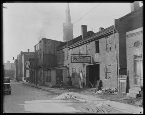 Saunier Brothers, blacksmiths (horse shoeing, wagon & repair works); exterior, 153-169 Saunier Avenue