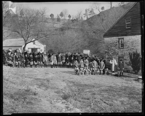 Blessing of the Hounds (Iroquois Hunt Club); group of people gathered around pack of dogs