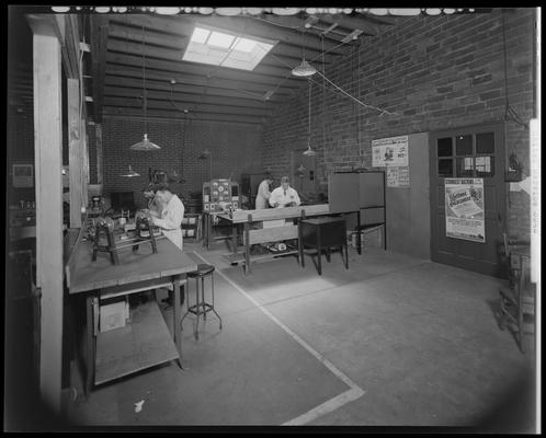 United Service; new department; electric; men working in interior