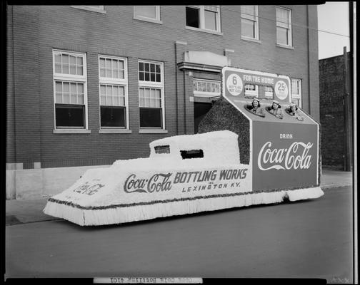Coca-Cola Bottling Works, 541 West Short; float in the shape of a six (6) pack of bottles, three (3) women riding on the float