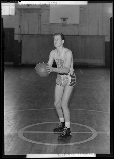 University of Kentucky varsity basketball team; individual team member on basketball court, number 15 (no. 15), Farnsley poised to throw ball