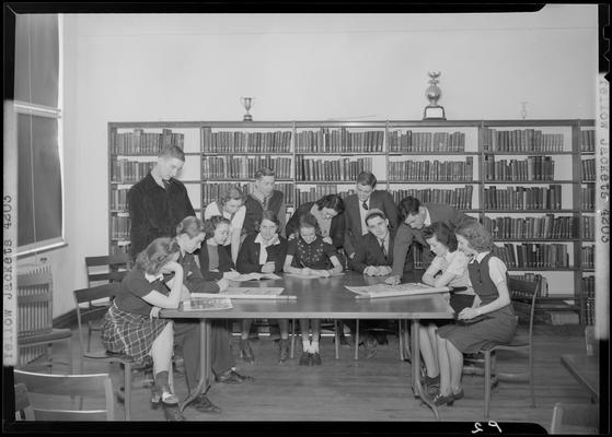 Versailles High School, Yellow Jackets; members sitting around a table in the library