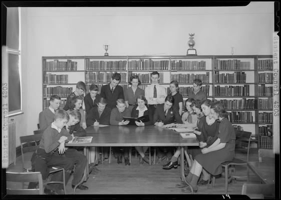 Versailles High School, Student Council; members sitting around a table in the library