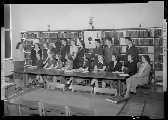 Versailles High School, Beta Club; members sitting around a table in the library