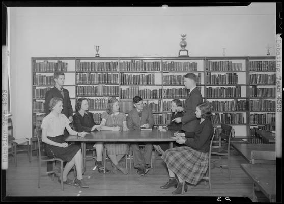 Versailles High School, Debating Team; members sitting around a table in the library