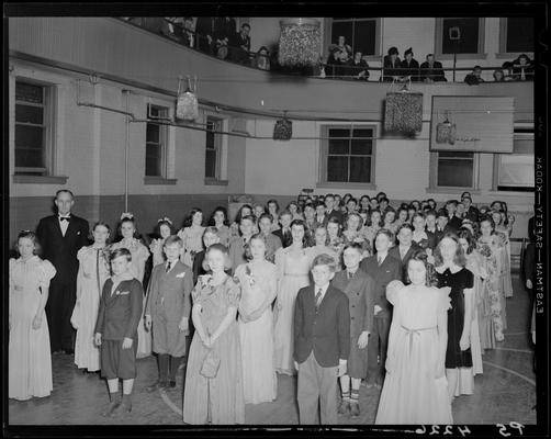 Margorie Hall; dance; girls and boys lined up on the dance floor (basketball court in the gymnasium)
