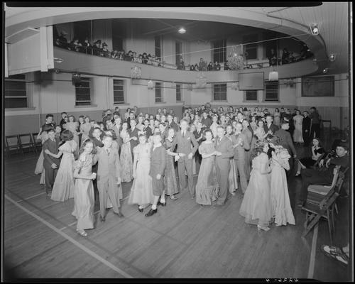 Margorie Hall; dance; girls and boys dancing on the dance floor (basketball court in the gymnasium)