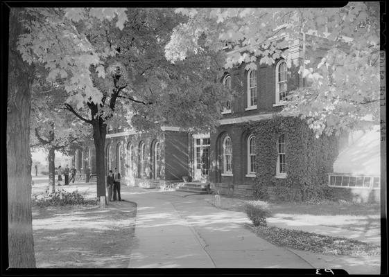 White Hall, (1940 Kentuckian) (University of Kentucky); exterior front view of building and walkway, students walking
