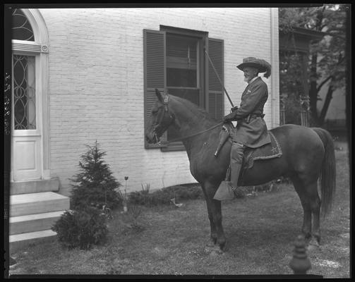 Colonel Dick Redd (in dress uniform); on horse