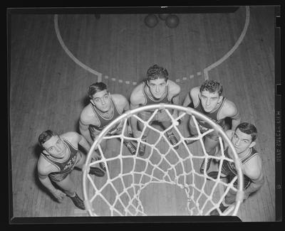 Group of players under basketball goal