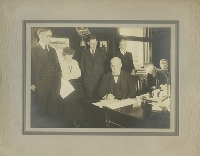 Group photo featuring President McVey and Governor Stanley, all names listed on back