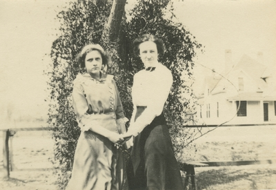 2 women standing outside