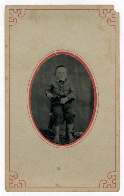 Hand-colored portrait of a boy.  Handwritten on verso,