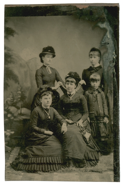 Group portrait of four unidentified women and one unidentified girl