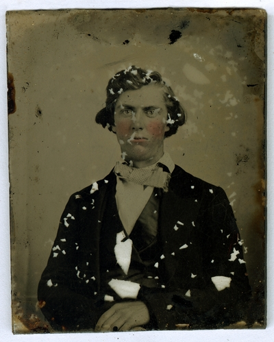 Hand-colored portrait of an unidentified man in a rectangular case