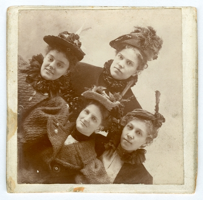 Framed photograph of four unidentified woman.  Handwritten on verso,