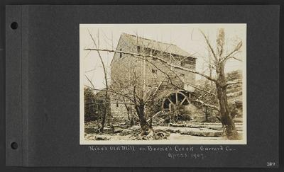 Wood and stone building with mill, surrounded by stumps and poossibly dead trees, notation                          Rice's Old Mill on Boone's Creek, Garrard Co, Apr. 28. 1907