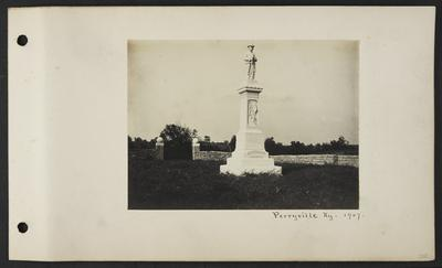Large marble memorial statue with man wearing hat and uniform with a mustache and gun, reads                          Nor braver bled for a brighter land, nor brighter land had cause so grand. Confederate Memorial, notation                          Perryville, KY 1907