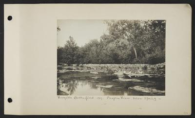 River with stone fence running along far back, multiple ducks standing on rocks in the middle of the river, notation                          Perryville Battlefield 1907 Chaplin River, below spring