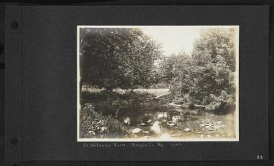 River with stone border on left side, plank leading from bank to little island, notation                          On Wilson's Run - Boyle Co. Ky. 1906
