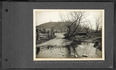 River crossing a low roadyway, wooden fencing on left with horse and small carriage in background, wooden bridge crossing river on right, notation                          Chaplin River (at crossing of Mitchelsburg Pike) 1906
