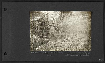 Log cabin and mill on left, brushy area with fallen trees, bluffs in background, caption                          Bill Meese's Mill - on the Cumberland- near Hermitage