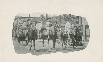 Three mounted men in a Memorial Day Parade, handwritten in ink on back: