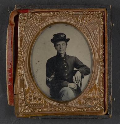 King Sulivan; served in the 4th Kentucky Volunteers, United States Army; noted in frame:                              King Sulivan, Ky. Vol., Co. F, 4th Reg, 3rd Div. Age'd 18 years. Brother-in-law of Joseph G. Gillis. Was kicked and killed by horse, three days after returning home to Ky. Served under Lieutenant Col. Harrison and Capt. Wood, 16 Ky. Volunteers