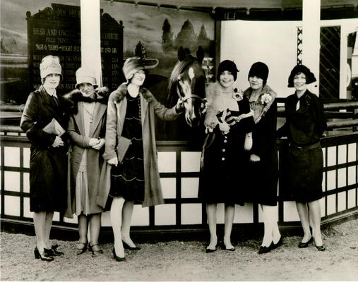 Horse Industry; Unidentified; Six ladies at a horse auction