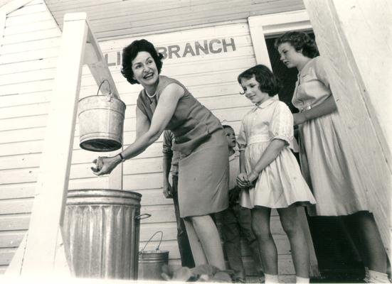 Johnson, Lyndon B. and Ladybird; Ladybird washing her hands; 1964, Red River, KY