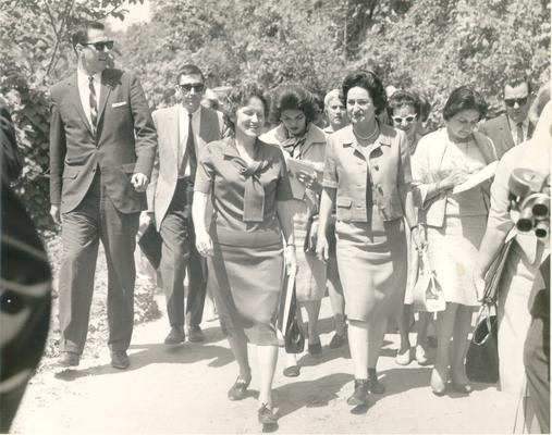 Johnson, Lyndon B. and Ladybird; The First Lady walking in a crowd