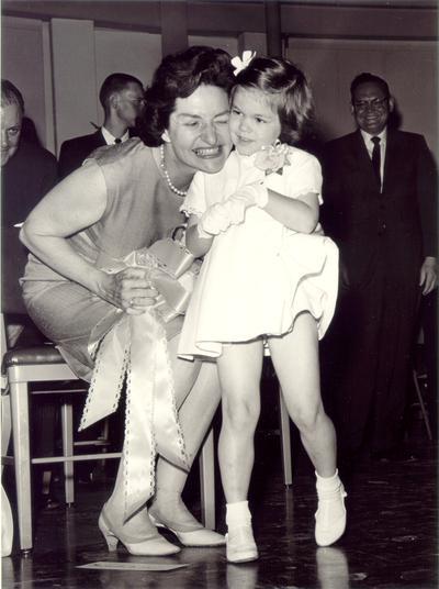 Johnson, Lyndon B. and Ladybird; Ladybird hugs a little girl, May 1964