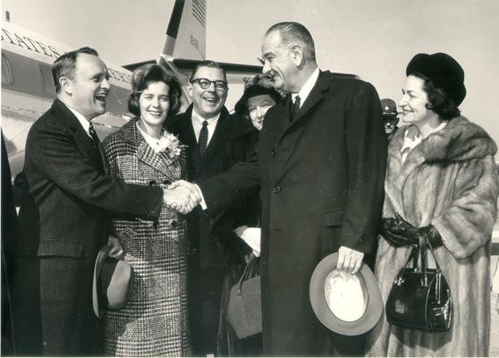 Johnson, Lyndon B. and Ladybird; Governor Edward T. Breathitt shaking hands with LBJ and Ladybird