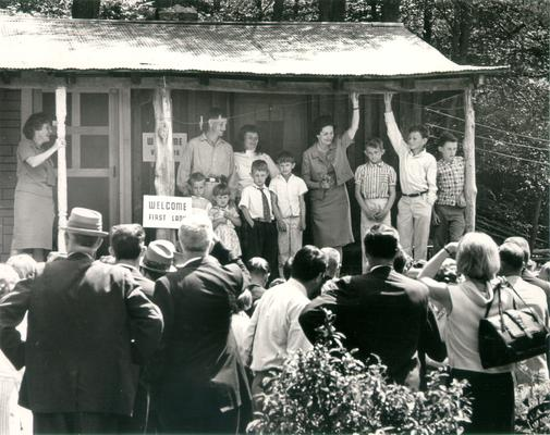 Johnson, Lyndon B. and Ladybird; Ladybird stands with a family on their front porch