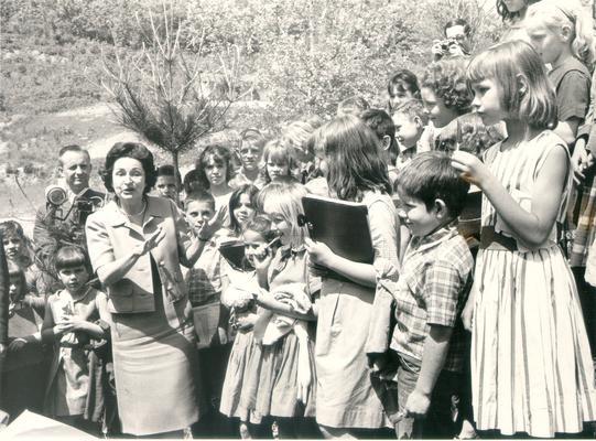 Johnson, Lyndon B. and Ladybird; Ladybird jokes with a crowd of children