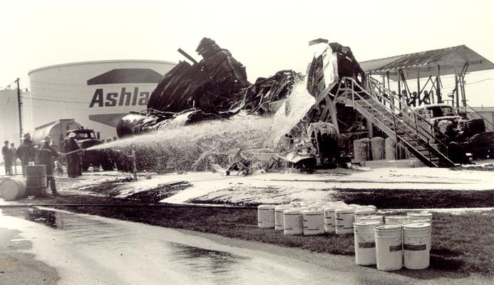 Ashland Bulk Oil Plant; 1973 Explosion and Fire; Firemen continue to spray down the wreckage