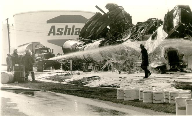Ashland Bulk Oil Plant; 1973 Explosion and Fire; Fireman spraying down tanker cab