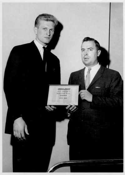 Nash, Cotton; Cotton Nash receives an award from the All-American Basketball Team, 1963