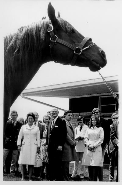 Princess Margaret; 1974; A crowd full of well-known people looking at a large horse
