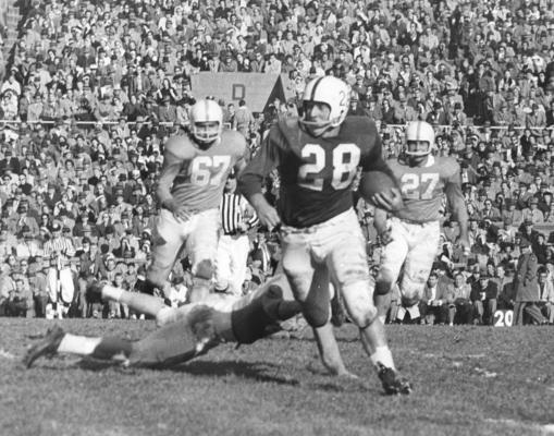 University of Kentucky; Football; Game Scenes; Halfback Bobby Cravens carries the ball in UK's 1958 victory over Tennessee