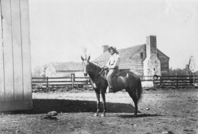 Posed photo; An African American man sitting on a horse. Silver Print
