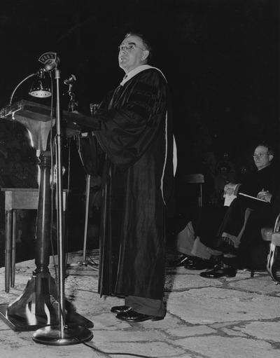 Crabb, Alfred L., Sr., pictured speaking at Summer 1948 Commencement in Memorial Hall Amphitheatre, Public Relations Department, Photographer: Mack Hughes