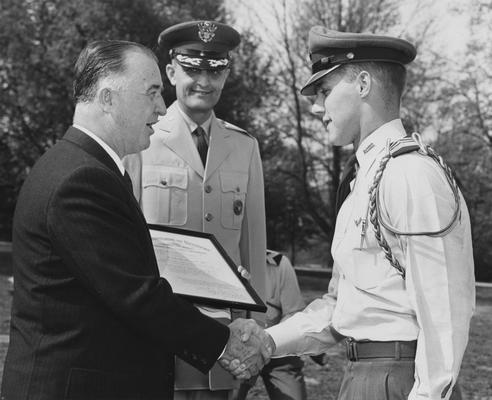 Craig, David C., Alumnus,, Air Reserve Officers Training Corps Cadet, pictured receiving certificate from Governor A. B. Chandler on UK ROTC Honors Day, also pictured is Colonel Roland W. Boughton, photographer: Lexington Herald Staff