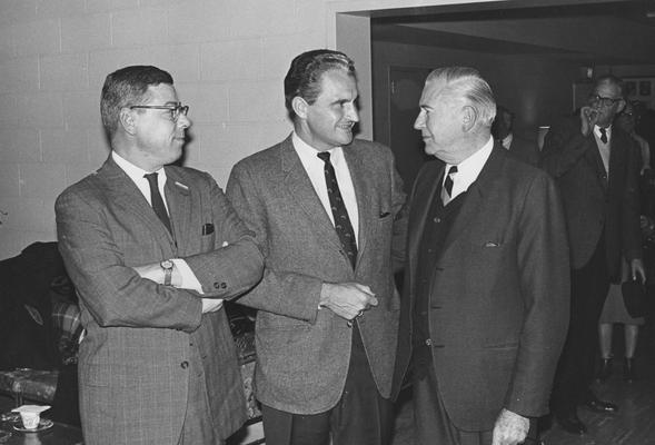 Creech, Glenwood L., Alumnus, B.S., 1941; M.S., 1950, Vice President of University of Kentucky Relations and Professor of Extension Education, Research Specialist in Vocational Education, 1965 - 1973, President of Florida Atlantic University, 1973 - 1983, pictured center with two unidentified individuals, Public Relations Department photograph