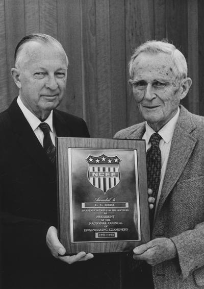 Crouse, Charles S., born 1888, died 1980, Professor and Chair, Department of Mining and Metallurgical Engineering born 1888, died 1980, pictured right receiving plaque from the National Council of Engineering Examiners representative Dwight W. Bray, a Frankfort engineer