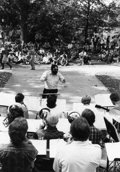 DiMartino, Vincent, Professor, Department of Music, Professional jazz trumpet player, band leader, pictured directing jazz band in front of Lafferty Hall, October 15, 1984
