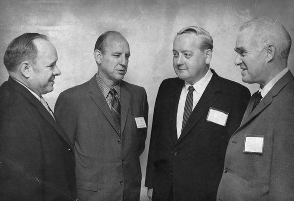 Drake, Robert M., Jr., Professor, Mechanical Engineering, Dean, College of Engineering, pictured second from left with three unidentified individuals, Lexington Herald - Leader staff photograph