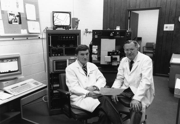 Ehmann, William D., Professor, Chemistry Department, pictured (right) with ? Markesbery