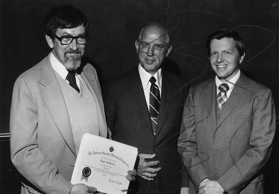 Eichhorn, Roger, Professor of Mechanical Engineering, Dean, College of Engineering, pictured (left) with two unidentified individuals
